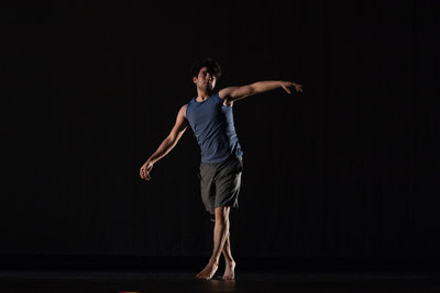 Studio Portrait of Dancer in dramatic studio lighting performing