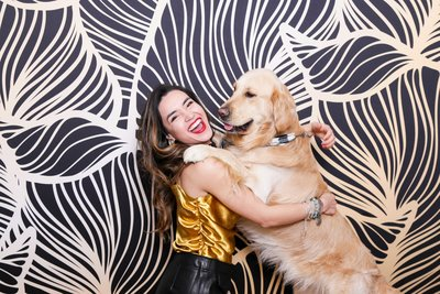 girl and doggy posing funny on a damask backdrop