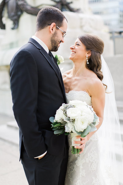 Bride and groom portrait in downtown Indianapolis taken by wedding photographers Ivan & Louise.