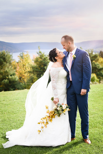 Couple lakeside at  upstate new  york Bristol Harbour wedding