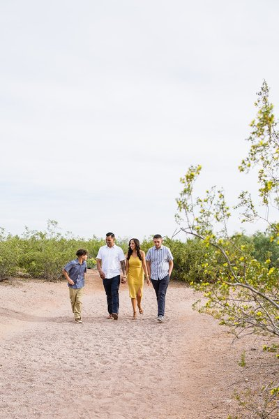 Family walking together during their spring family photography session at Papago Park by Arizona family photographer PMA Photography.