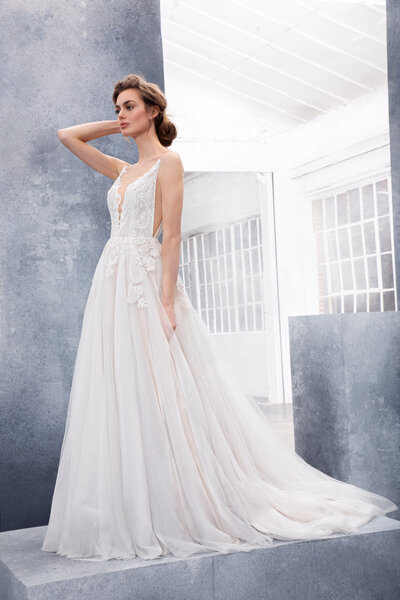 Hayley Paige bridal gown - Ivory labyrinth caviar A-line gown, deep sweetheart neckline and open back, full tulle skirt with caviar applique and layered starlight tulle with cashmere lining.
