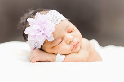 Dreamcatcher Rose Studios - Lifestyle Newborn - manhattan - baby laying on arms - flower crown