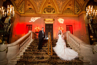 An indoor bride and groom portrait on a gorgeous  stairs.