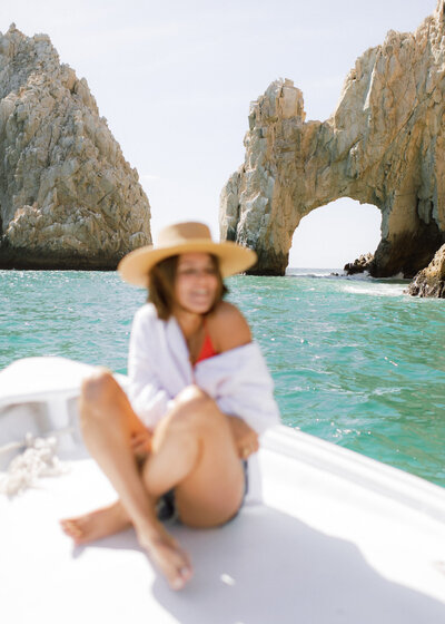 Girl on boat in Cabo, Mexico
