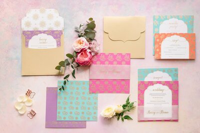 Pastel and gold invitation suite