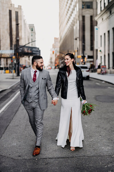couple walking down city street