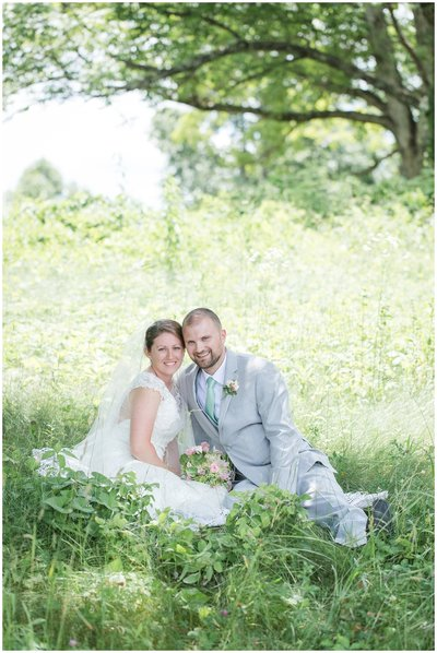Bride and Groom in flower field at their all inclusive wedding package