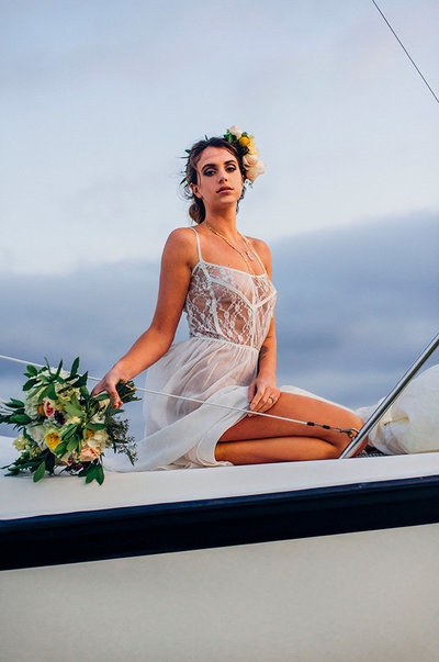 woman on sail boat with bouquet  for boudoir collective feature