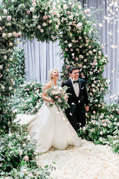 bride-groom-ceremony-floral-arch