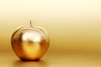 bigstock-gold-apple-on-gold-background-12520433