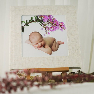 Flushmount album featuring professional newborn photography on cover