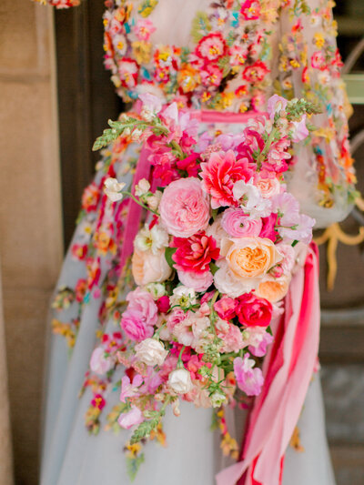 colorful floral dress and wedding bouquet