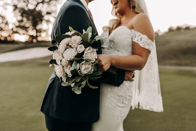 J.Michelle Photography is an atlanta, ga photographer captures a bride and groom's laughter after their wedding at horseshoe bend country club