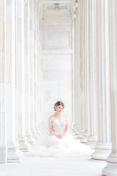 Toledo Museum of Art Wedding bride is in Pronovias Gown with white columns and European looking venue