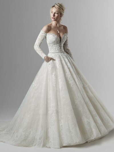 Off-the-Shoulder Bridal Ball Gown Favorite Love a statement fashion piece? We designed this off-the-shoulder bridal gown with your megawatt jewelry collection in mind.