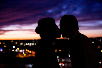 silhouette of bride and groom kissing at sunset after their wedding for a picture by San Antonio Wedding Photographer