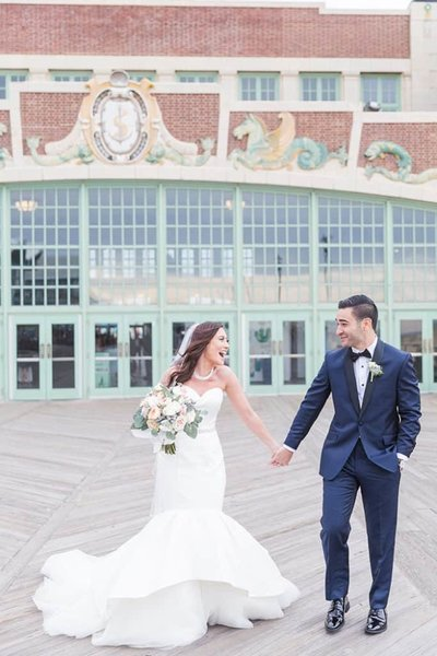 Bride and groom hold hands outside Tim McLoone's Supper Club wedding