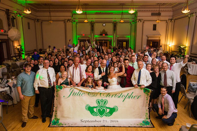 Photo of bride, groom and guests in the Grand Ballroom at a Masonic Temple wedding