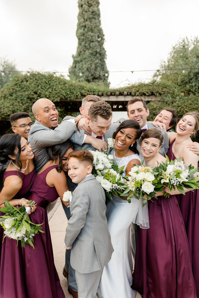 Photographer captures candid photo of bridal party at wedding in Phoenix