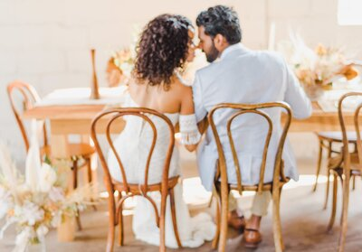 bride and groom kissing at head table
