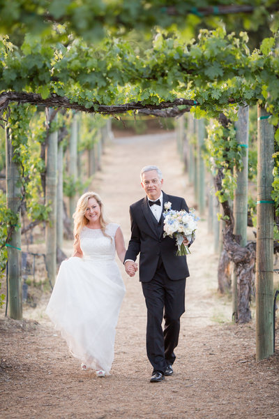 Couple walking through the vineyard at Wilson Creek Winery