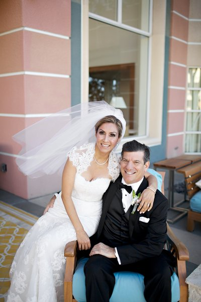 Bride and Groom sitting on  bench at Coronado community center