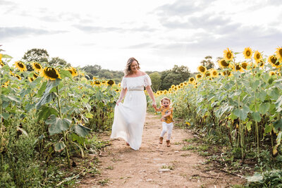 Family photos at the Sussex County Sunflower Maze . Baltic Born White dress.