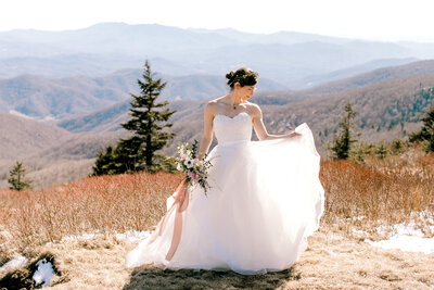 bride fluffs dress
