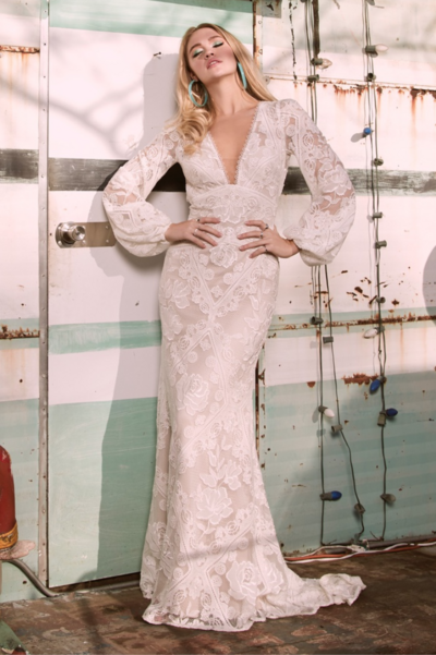 Sunlit Lace features beautiful floral embroidery filled with chiffon creating a delicate stain glass window effect. Rosebay has an empire waist and V-neckline with dramatic long sleeves and a fit and flare skirt with a back train godet.