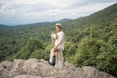 Boho bride in the mountains on her mountain elopement package