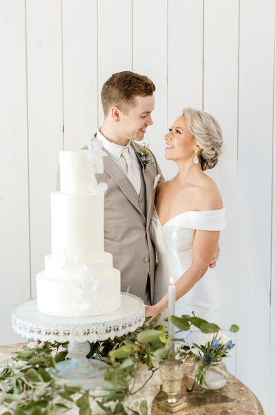 elegant elopement cake cutting on the beach
