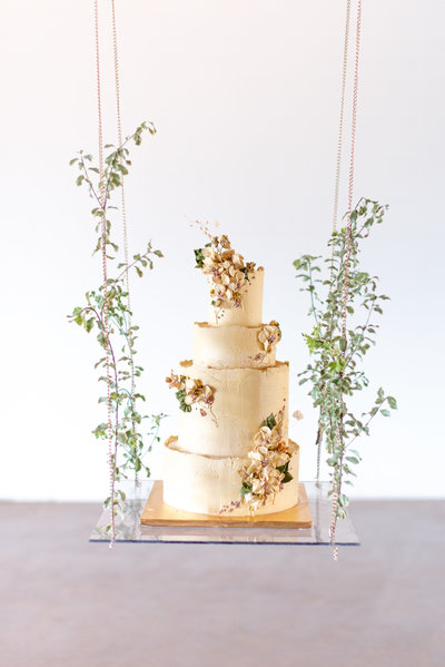 wedding cake hanging on glass