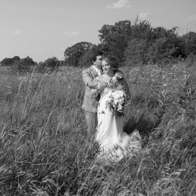 AmandaGregWeddingS476 bride and groom in field of flowers adventure wedding elopement willow marie photography
