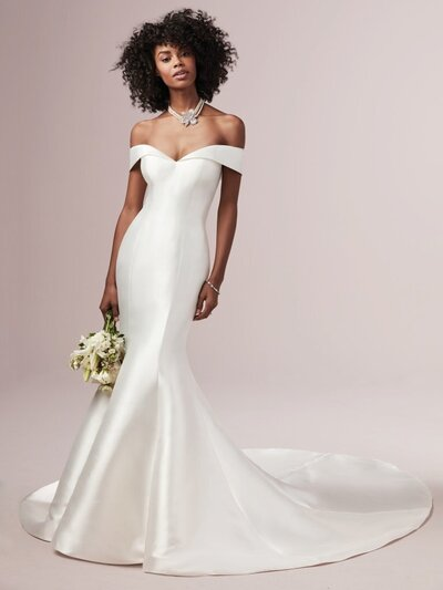 Off-the-Shoulder Fit-and-Flare Wedding Dress. Huron Mikado creates this exquisite fit-and-flare wedding dress featuring a sweetheart neckline with off-the-shoulder sleeves and covered buttons trailing down the train. Finished with covered buttons over zipper closure.