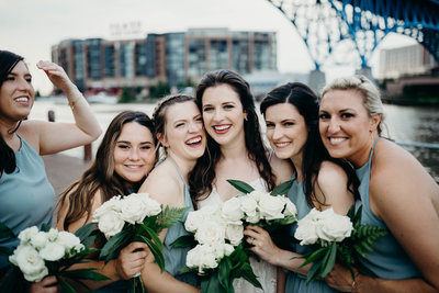 bridesmaids & bride smiling