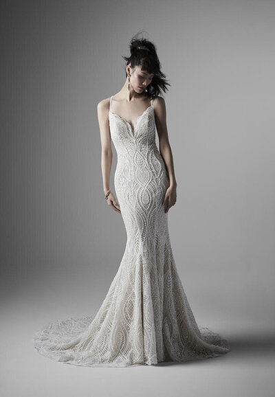 Lace Mermaid Wedding Gown. Lace is ace. (You've imagined it can do many things.) Simple is pretty. Vintage is romantic. And occasionally, it's a vision in form and sophistication. We're especially smitten with how it lines the illusion halter back in this divine lace mermaid wedding gown.