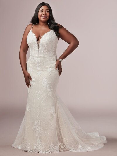 A romantic off-shoulder neckline and beautifully ornate appliques are the focal points of thie ballgown.