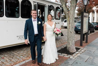A bride and groom exit their trolley at their New Bedford Whaling Museum wedding