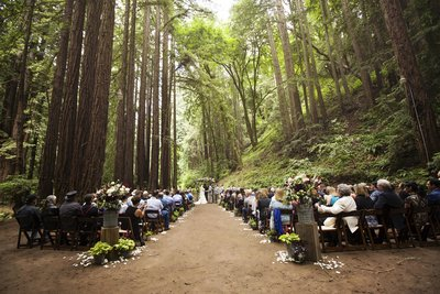 Wedding Ceremony among redwoods with florals