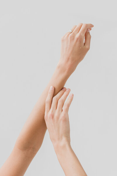 hands in the air on a blank backdrop by costola photography
