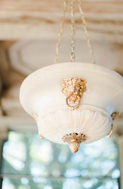 Elegant light fixture in Old Westbury Gardens Mansion, Lion Head
