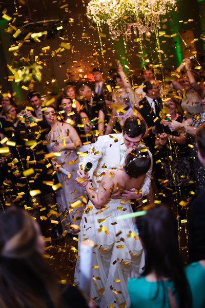 Couple celebrate under confetti at the Ivy in Flowood Mississippi