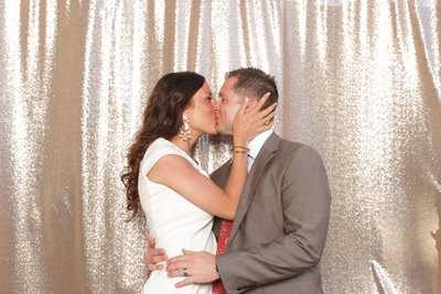 bride and groom kissing in photo booth