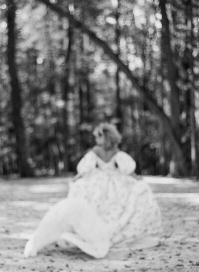 Beautiful bride in wedding gown runs towards a forest