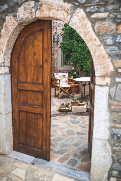 Open Door inviting you into elegant and peaceful garden courtyard