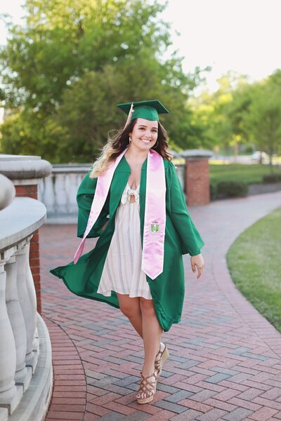girl smiling wearing graduation cap and gown