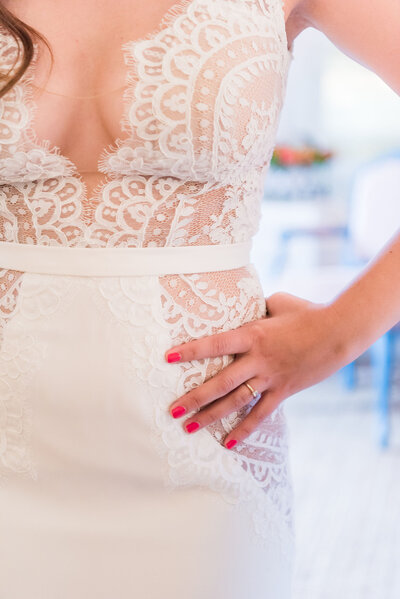 Gorgeous lace details of wedding gown on bride