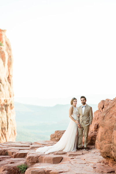 An elegant couple on a cliff at Cathedral Rock, in Sedona
