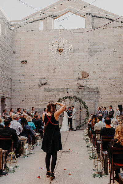Behind the Scenes photo of Phoenix Photographer photographing a wedding ceremony at the Ice House
